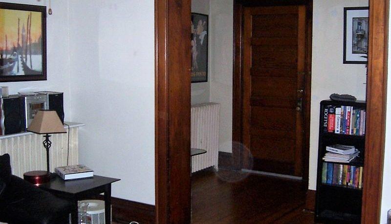 612-clinton-street-Living-Room-front door_iowa-city_j-and-j-apartments