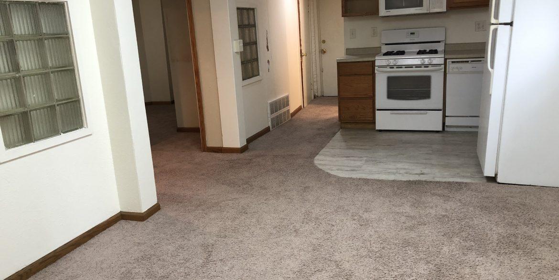 611-clinton-street_living-room-kitchen_iowa-city_j-and-j-apartments